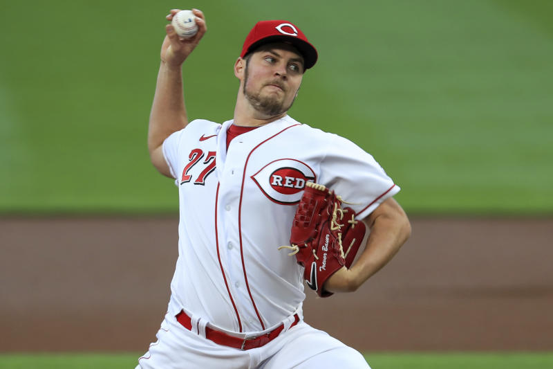 Cincinnati Reds' Trevor Bauer throws in the first inning during a baseball game against the Chicago White Sox in Cincinnati, Saturday, Sept. 19, 2020. (AP Photo/Aaron Doster)
