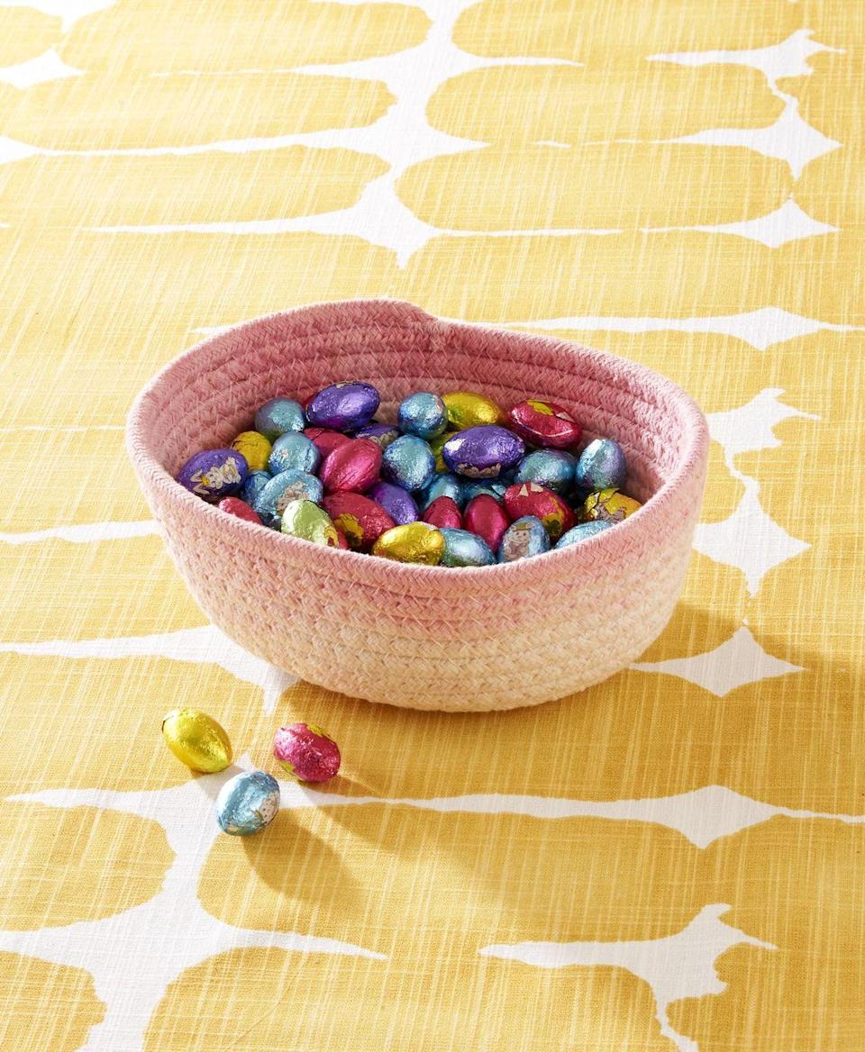 "<p>A simple dyed cotton basket will add pops of color for storing candy or utensil on the Easter Table. </p><p><strong>To make:</strong> Dip the top quarter of a cotton basket in desired color of fabric dye. When dry, fill with moss and Easter eggs or candy.</p><p><a class=""link rapid-noclick-resp"" href=""https://www.amazon.com/Farmlyn-Creek-Baskets-Storage-Organizers/dp/B08D8S7LMX/ref=sr_1_3?tag=syn-yahoo-20&ascsubtag=%5Bartid%7C10050.g.1652%5Bsrc%7Cyahoo-us"" rel=""nofollow noopener"" target=""_blank"" data-ylk=""slk:SHOP BASKETS"">SHOP BASKETS</a></p>"