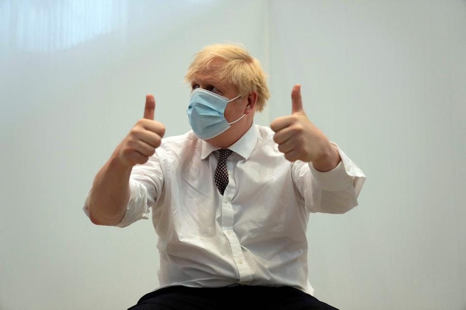 Britain's Prime Minister Boris Johnson gives a thumbs up after receiving his second jab of the Oxford/AstraZeneca Covid-19 vaccine  at the Francis Crick Institute in central London on June 3, 2021. (Photo by Matt Dunham / POOL / AFP) (Photo by MATT DUNHAM/POOL/AFP via Getty Images)