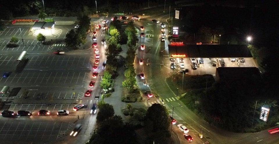 Motorists queue to fill their cars at a Sainsbury's fuel station in Ashford, Kent (Gareth Fuller/PA) (PA Wire)
