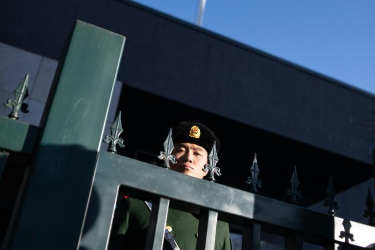 A Chinese police officer stands guard at the Australian embassy in Beijing