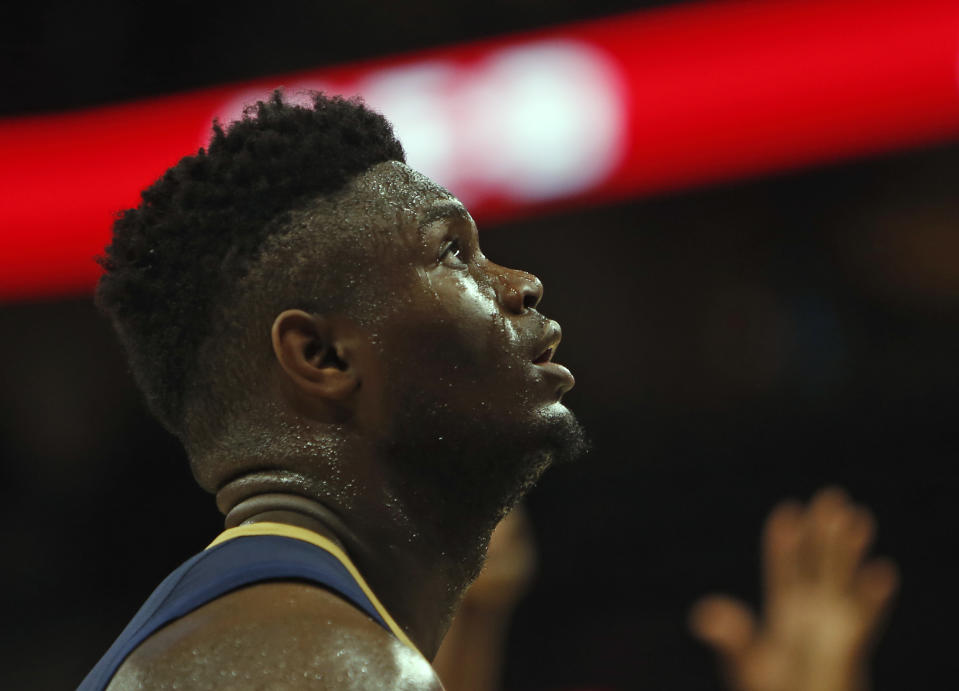 SAN ANTONIO,TX - OCTOBER 13:  Zion Williamson #1  of the New Orleans Pelicans watches a foul shot taken against the San Antonio Spurs in a pre-season game  at AT&T Center on October 13 , 2019 in San Antonio, Texas.  NOTE TO USER: User expressly acknowledges and agrees that , by downloading and or using this photograph, User is consenting to the terms and conditions of the Getty Images License Agreement. (Photo by Ronald Cortes/Getty Images)