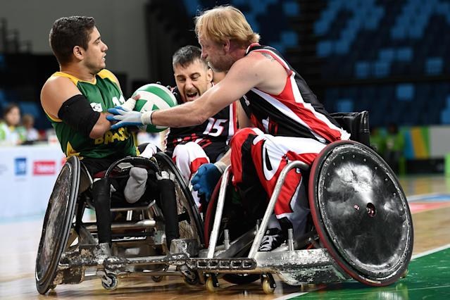 RIO DE JANEIRO, BRAZIL - FEBRUARY 26: Julio Cesar Braz of Brazil competes against Patrice Simard (B) and Garret Deane Hickling of Canada during the International Wheelchair Rugby Championship - Aquece Rio Test Event for the Rio 2016 Paralympics match between Brazil and Canada at Olympic Park on February 26, 2016 in Rio de Janeiro, Brazil. (Photo by Buda Mendes/Getty Images)