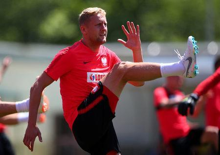Soccer Football - World Cup - Poland Training - Poland Training Camp, Sochi, Russia - June 14, 2018 Poland's Kamil Glik during training REUTERS/Hannah McKay