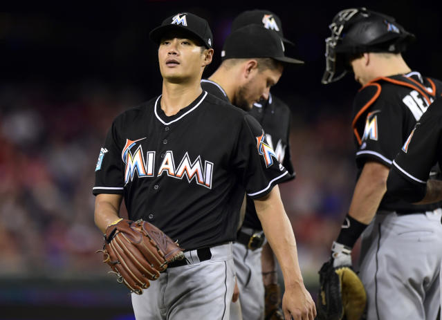 Miami Marlins starting pitcher Wei-Yin Chen, left, of Taiwan, leaves the field during the fifth inning of a baseball game against the Washington Nationals at Nationals Park in Washington, Saturday, July 7, 2018. (AP Photo/Susan Walsh)