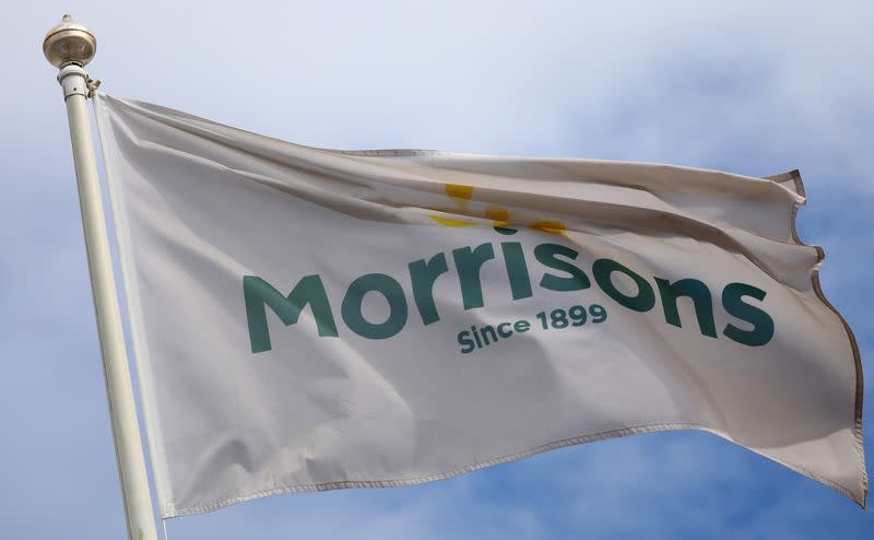 FILE PHOTO: A flag flies outside a Morrisons supermarket in New Brighton