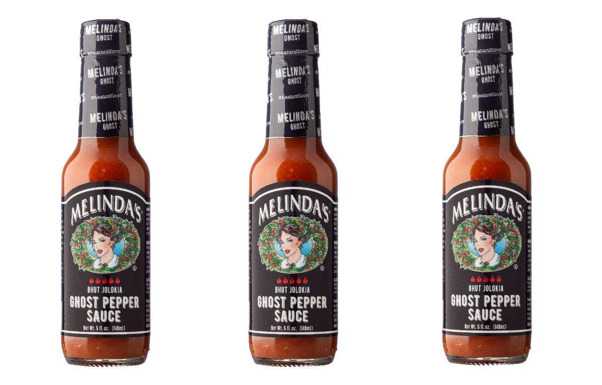 """<p>Melinda's The Ghost has something sweet to it — carrots, papaya, lime and passion fruit — but the bhut jolokia chile (or ghost pepper) has a brutal bite. At 1 million Scoville units, this slightly tangy hot sauce brings the heat. One Amazon reviewer thinks it hasn't quite reached the """"melt your face"""" threshold but says <a href=""""https://www.thedailymeal.com/eat/unexpected-ingredients-eggs?referrer=yahoo&category=beauty_food&include_utm=1&utm_medium=referral&utm_source=yahoo&utm_campaign=feed"""">it's great with eggs</a> and <a href=""""https://www.thedailymeal.com/eat/regional-american-chili-styles?referrer=yahoo&category=beauty_food&include_utm=1&utm_medium=referral&utm_source=yahoo&utm_campaign=feed"""">chili</a>.</p>"""