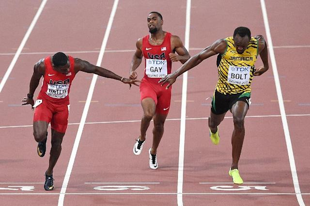Usain Bolt (right) outpaces Justin Gatlin (left) and Tyson Gay to win the men's 100m in Beijing (AFP Photo/Pedro Ugarte)