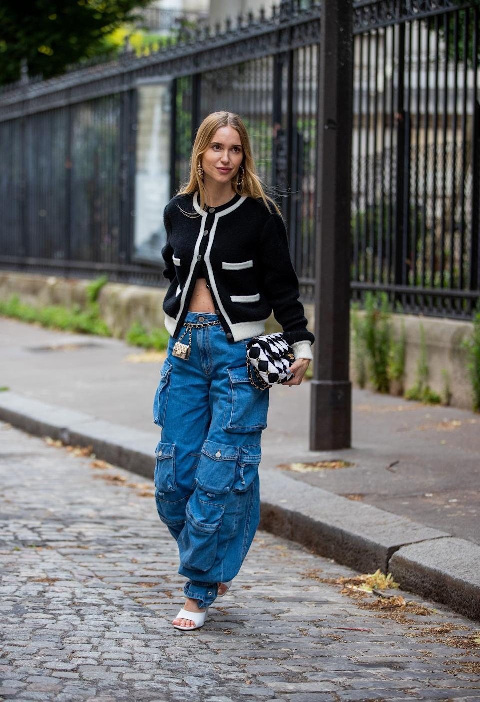 <p>Give baggy denim the chic treatment with a textured cardigan and heels. </p>