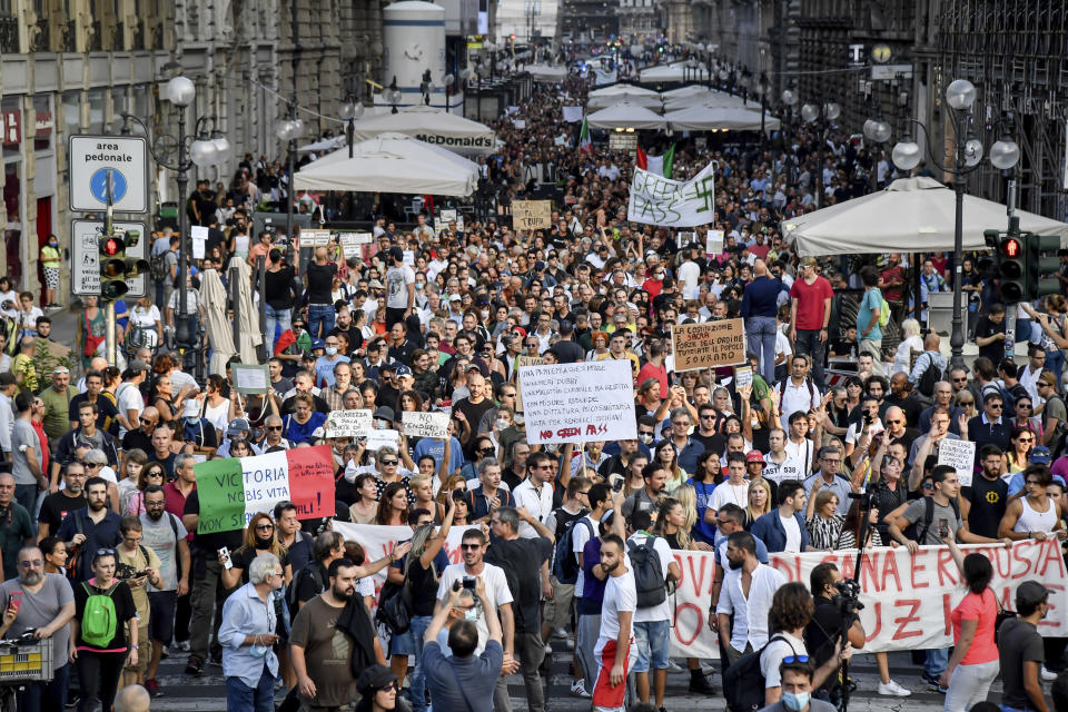 People march during a protest against the COVID-19 health pass, in Milan, Italy, Saturday, Sept. 18, 2021. Italian workers in both the public and private sectors must display a health pass to access their workplaces from Oct. 15 under a decree adopted by Premier Mario Draghi's broad-based coalition government. (Claudio Furlan/LaPresse via AP)