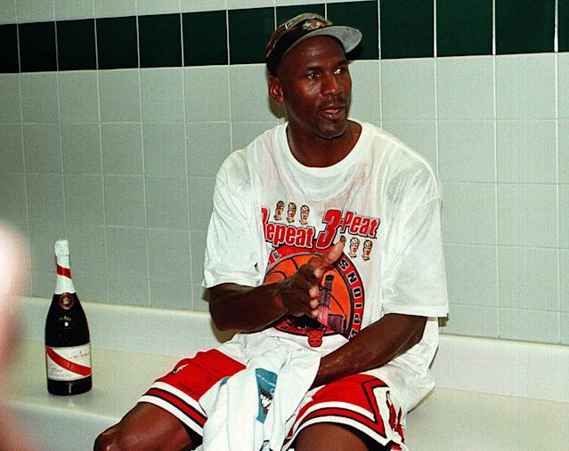 Michael Jordan sits in the locker room after the Bulls won their sixth NBA title. (Charles Cherney/Chicago Tribune/Tribune News Service via Getty Images)