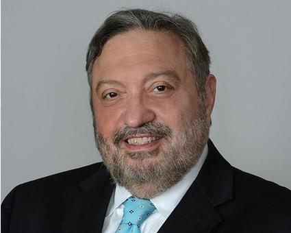 Meet Louis Terminello: law firm partner, adjunct professor, hero to party lovers everywhere.