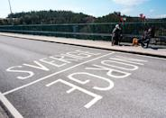 On the Svinesund bridge, the 73-year-old Swedish twins keep to their own side of the white line