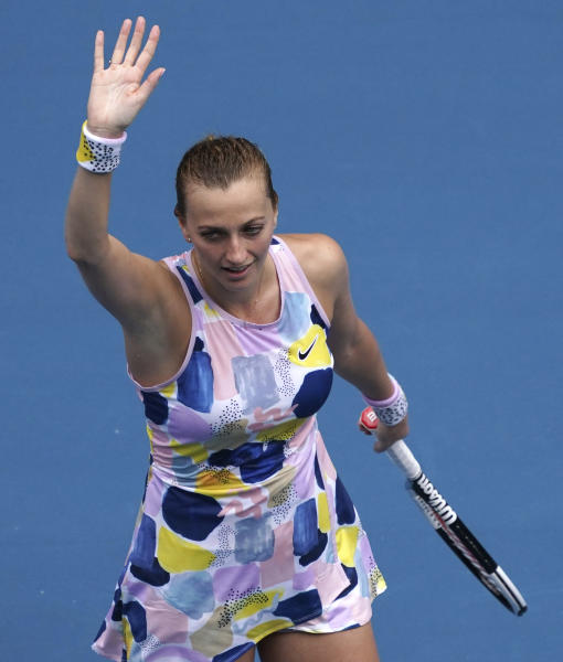 Petra Kvitova of the Czech Republic waves after defeating Greece's Maria Sakkari in their fourth round singles match at the Australian Open tennis championship in Melbourne, Australia, Sunday, Jan. 26, 2020. (AP Photo/Lee Jin-man)