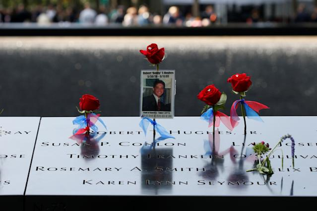 <p>Flowers and mementos are seen left among names at the edge of the south reflecting pool at the National 9/11 Memorial and Museum during ceremonies marking the 16th anniversary of the September 11, 2001 attacks on the World Trade Center in New York, Sept. 11, 2017. (Photo: Brendan McDermid/Reuters) </p>