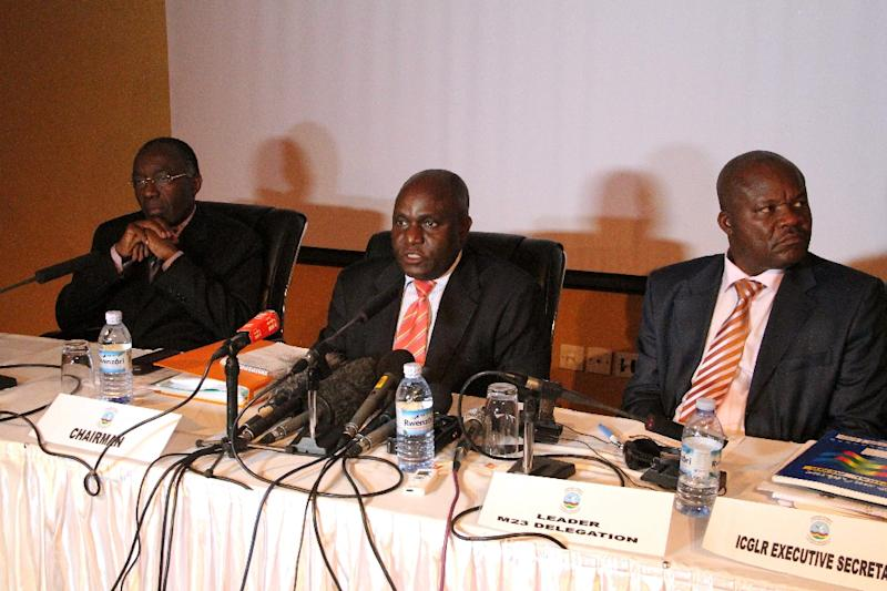 Crispus Kiyonga (centre) at a press conference on February 6, 2013 in Kampala on peace talks with the M23 rebels (AFP Photo/Isaac Kasamani)