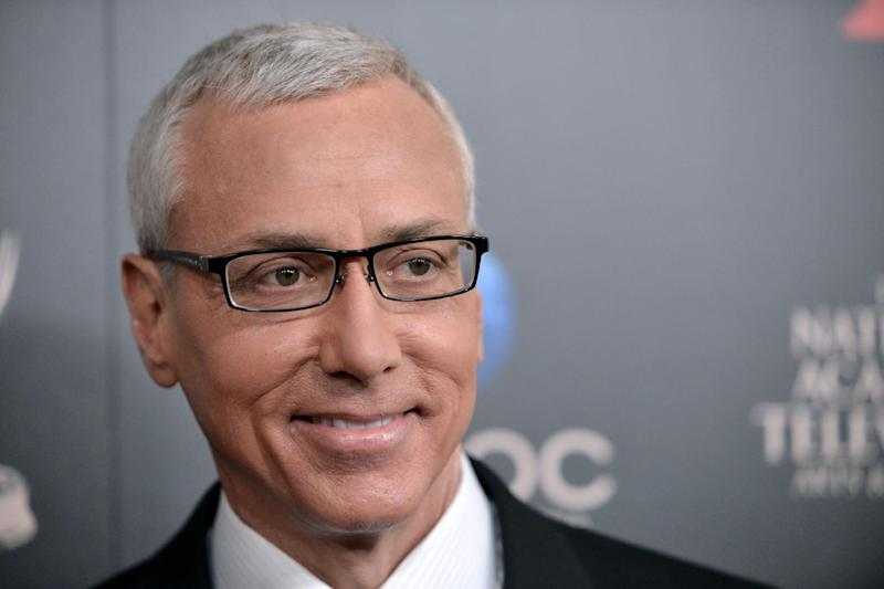 """FILE - In this June 16, 2013 file photo, Dr. Drew Pinsky arrives at the 40th Annual Daytime Emmy Awards, in Beverly Hills, Calif. Pinsky says he had his prostate removed earlier this year after discovering he had cancer. The host of HLN's """"Dr. Drew on Call"""" wrote Tuesday, Sept. 24, 2013, on the network's site that he returned to work in 10 days after having a robotic prostatectomy in July. (Photo by Richard Shotwell/Invision/AP, File)"""