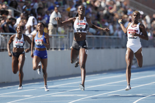 Shakima Wimbley crosses the finish line ahead of Wadeline Jonathas, right, while winning the women's 400-meter dash final at the U.S. Championships athletics meet, Saturday, July 27, 2019, in Des Moines, Iowa. (AP Photo/Charlie Neibergall)