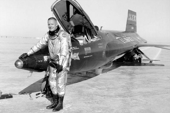 Research pilot Neil Armstrong stands with an X-15 rocketplane at NASA's Flight Research Center, Edwards, Calif., in 1960.