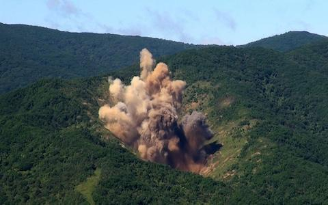 In this handout image provide by South Korean Defense Ministry, A bomb hits a mock target at the Pilseung Firing Range - Credit: South Korean Defense Ministry via Getty Images