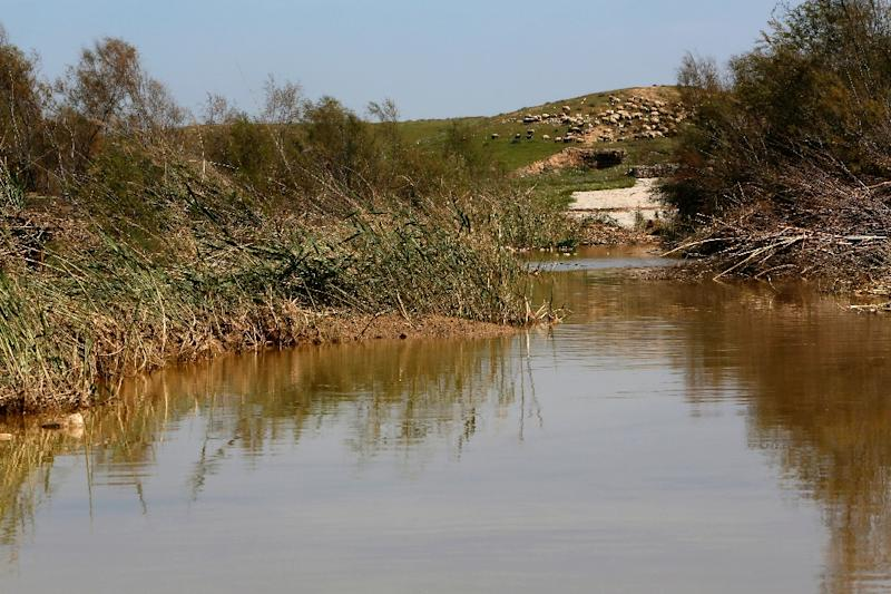 Israel says heavy rainfall contributed to the flooding in the Gaza Strip, and a small flow of water is all that remains at Nahal Besor (AFP Photo/Gali Tibbon)
