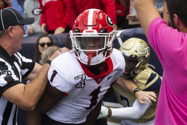 Referees separate Georgia wide receiver George Pickens (1) and Georgia Tech defensive back Tre Swilling during a scuffle in the end zone during the second half of an NCAA college football game Saturday, Nov. 30, 2019 in Atlanta. Georgia won 52-7. (AP Photo/John Amis)