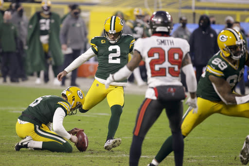 Green Bay Packers kicker Mason Crosby (2) kicks a 26-yard field goal against the Tampa Bay Buccaneers during the second half of the NFC championship NFL football game in Green Bay, Wis., Sunday, Jan. 24, 2021. (AP Photo/Mike Roemer)
