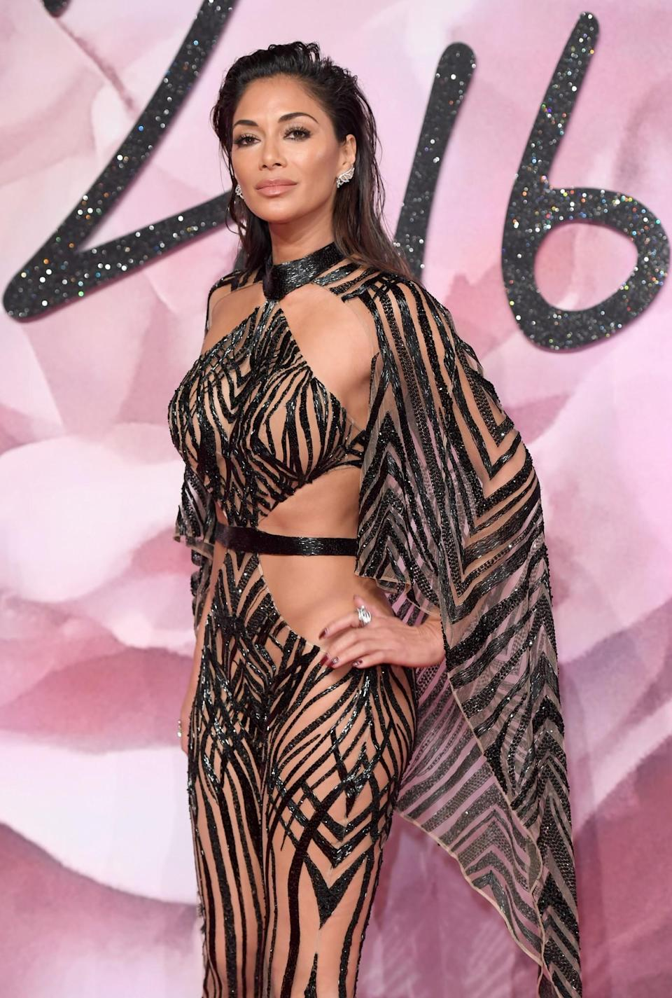 <p>Now: Scherzinger has gone on to have a very successful solo career, she also became a judge on The X Factor and over the years has become the face of Herbal Essences and Muller. [Photo: Getty] </p>
