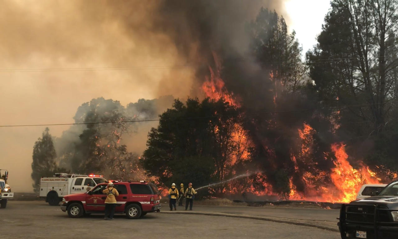 <p>In this photo provided by the Cal Fire Communications, firefighters battle a wildfire in an area northeast of Clearlake Oaks, Calif., Sunday, June 24, 2018 Wind-driven wildfires destroyed buildings and threatened hundreds of others Sunday as they raced across dry brush in rural Northern California. (Photo: Jonathan Cox/Cal Fire Communications via AP) </p>