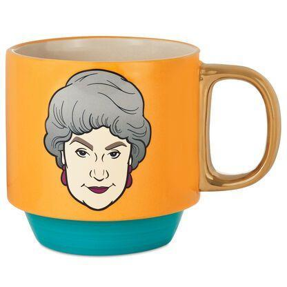 """<p>hallmark.com</p><p><strong>$16.99</strong></p><p><a href=""""https://www.hallmark.com/gifts/kitchen/mugs-and-teacups/dorothy-the-golden-girls-mug-17.5-oz.-1GOL1015.html"""" rel=""""nofollow noopener"""" target=""""_blank"""" data-ylk=""""slk:Shop Now"""" class=""""link rapid-noclick-resp"""">Shop Now</a></p><p>Start your morning with coffee and the 'Girls. Also available in <a href=""""https://www.hallmark.com/gifts/kitchen/mugs-and-teacups/sophia-the-golden-girls-mug-17.5-oz.-1GOL1016.html?source=igodigital"""" rel=""""nofollow noopener"""" target=""""_blank"""" data-ylk=""""slk:Sophia"""" class=""""link rapid-noclick-resp"""">Sophia</a>, <a href=""""https://www.hallmark.com/gifts/kitchen/mugs-and-teacups/blanche-the-golden-girls-mug-17.5-oz.-1GOL1017.html?source=igodigital"""" rel=""""nofollow noopener"""" target=""""_blank"""" data-ylk=""""slk:Blanch"""" class=""""link rapid-noclick-resp"""">Blanch</a>e and <a href=""""https://www.hallmark.com/gifts/kitchen/mugs-and-teacups/rose-the-golden-girls-mug-17.5-oz.-1GOL1018.html?source=igodigital"""" rel=""""nofollow noopener"""" target=""""_blank"""" data-ylk=""""slk:Rose"""" class=""""link rapid-noclick-resp"""">Rose</a>, these mugs have quotes from each leading lady on the opposite side.</p>"""