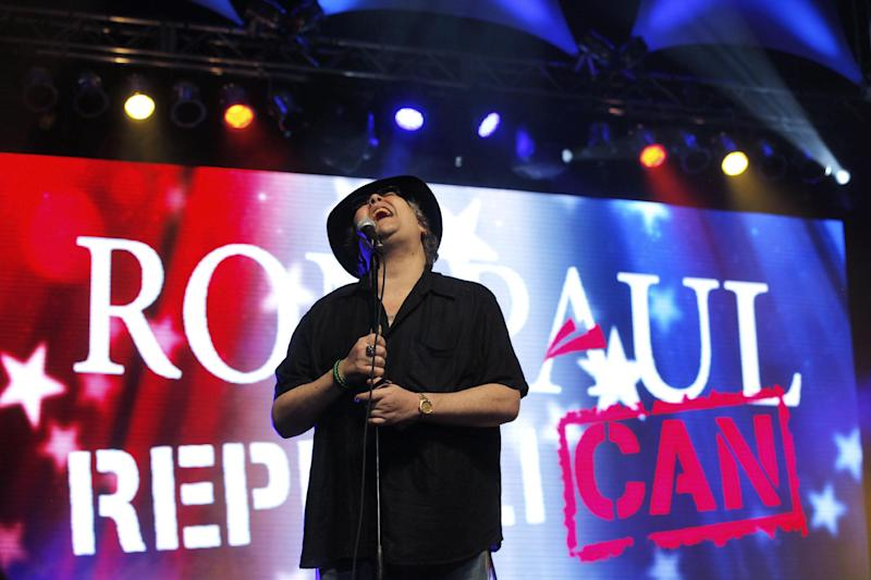 John Popper of Blues Traveler performs at a rally for Rep. Ron Paul, R-Texas, at the University of South Florida Sun Dome on the sidelines of the Republican National Convention in Tampa, Fla., on Sunday, Aug. 26, 2012. (AP Photo/Charles Dharapak)