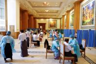 Parliament members and workers receive the Covishield coronavirus disease (COVID-19) vaccine in Naypyidaw
