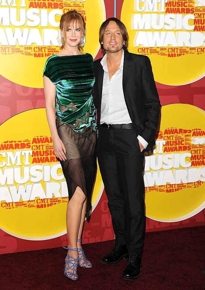 """A disastrously-dressed Nicole Kidman and her nominated hubby, Keith Urban, clung to one another as they made their way down the red carpet. Seriously, what was she thinking?! Jon Kopaloff/<a href=""""http://www.filmmagic.com/"""" target=""""new"""">FilmMagic.com</a> - June 8, 2011"""