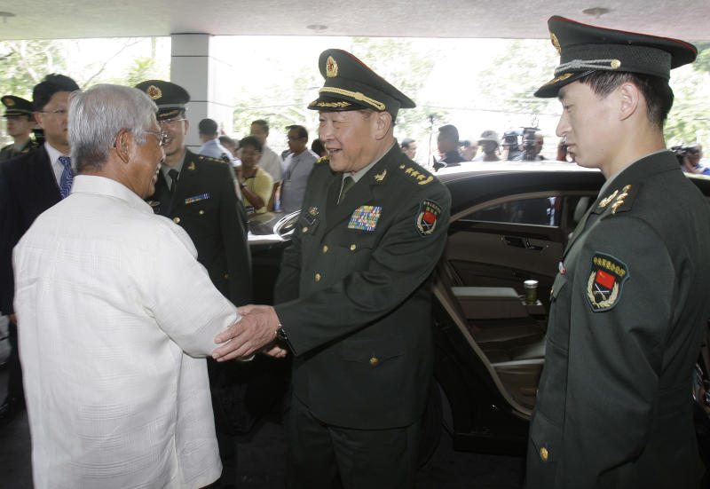 Chinese Defense Minister Liang Guanglie, center, bids goodbye to his Philippine counterpart Voltaire Gazmin, left, at the Defense Headquarters in suburban Quezon City, north of Manila, Philippines on Monday May 23, 2011. Guanglie's visit comes amid renewed tension over the disputed Spratly's Islands which are claimed by China, Philippines and four other asian countries and terrotorites. Washington has expressed concerns that the disputes could hamper access to one of the world's busiest commercial sea lanes. (AP Photo/Aaron Favila)