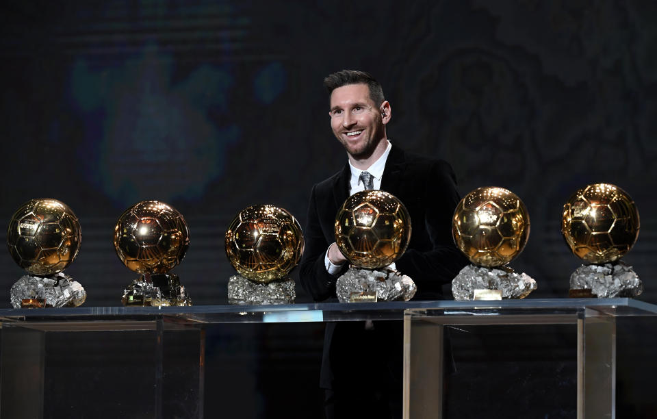 Lionel Messi poses and celebrates onstage after winning his sixth Ballon D'Or award during the Ballon D'Or.