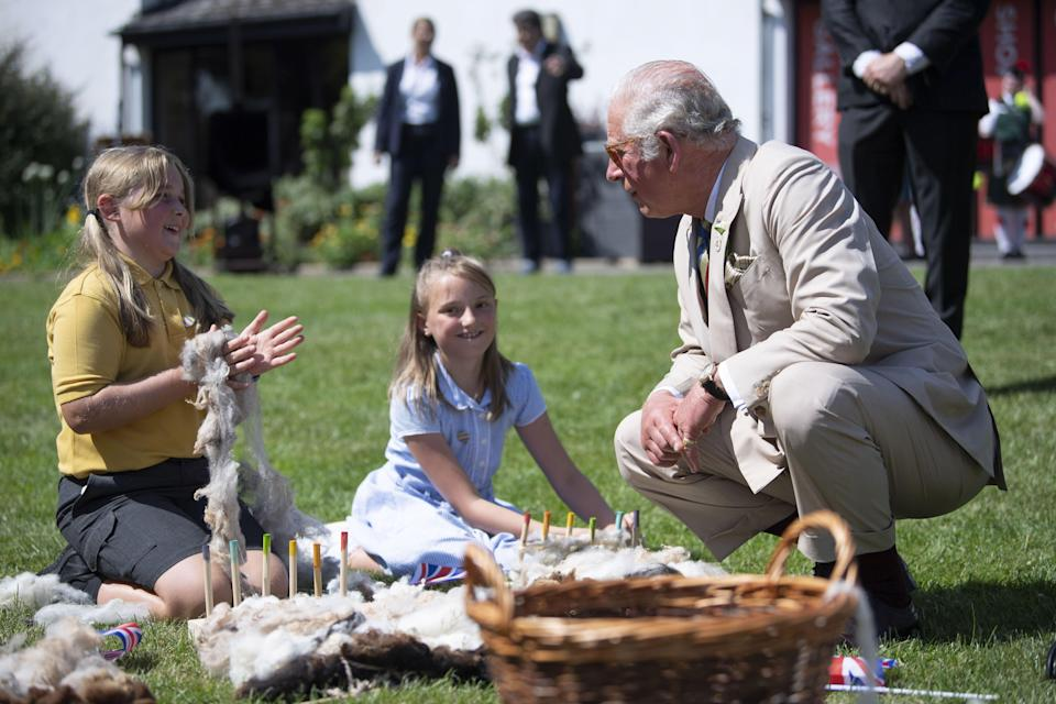 The Prince of Wales attending a gathering of the town's community groups and young people in the nearby Victoria Park (David Rose/Daily Telegraph) (PA Wire)