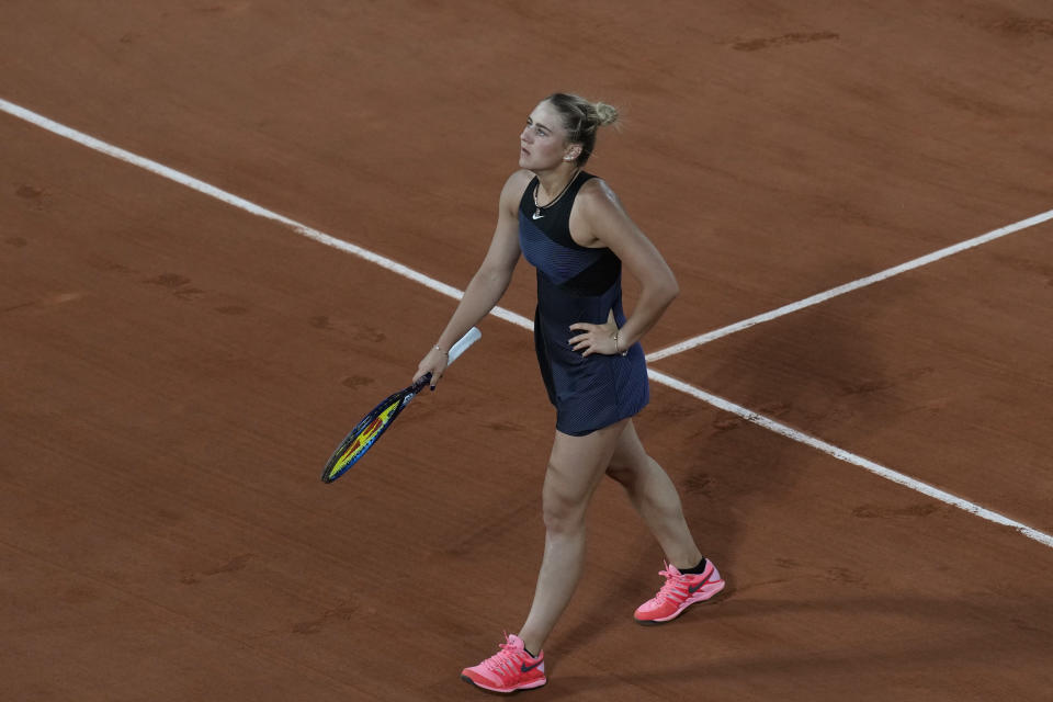 Ukraine's Marta Kostyuk reacts after missing a shot as she plays against Poland's Iga Swiatek during their fourth round match on day 9, of the French Open tennis tournament at Roland Garros in Paris, France, Monday, June 7, 2021. (AP Photo/Christophe Ena)