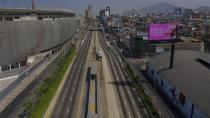 People ride bicycles in an empty highway in Lima, Peru, Sunday, Jan. 31, 2021. Peruvian authorities are instituting a complete lockdown in multiple regions including the capital due to a resurgence in COVID-19 cases that has taxed healthcare services to their maximum capacity. (AP Photo/Rodrigo Abd)