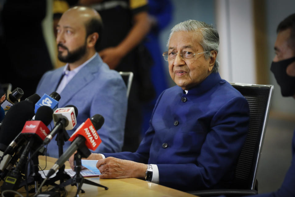 Former Prime Minister Mahathir Mohamad, right, speaks during a press conference in Kuala Lumpur, Friday, Aug. 7, 2020. Mahathir, 95, said Friday he would form a new ethnic Malay party to fight corrupt leaders, more than two months after he was sacked from his own party amid a political struggle with his successor. (AP Photo/Vincent Thian, Pool)