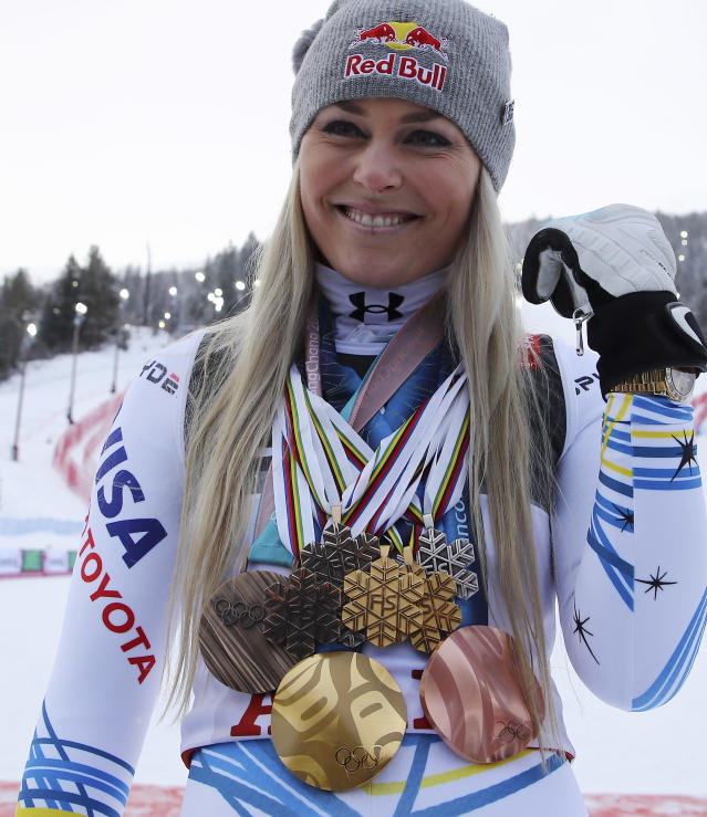 United States' Lindsey Vonn poses with her career's medals in the finish area after the women's downhill race, at the alpine ski World Championships in Are, Sweden, Sunday, Feb. 10, 2019. (AP Photo/Marco Trovati)