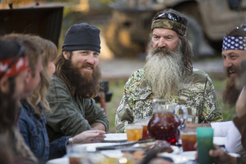 "This undated image released by A&E shows Phil Robertson, flanked by his sons Jase Robertson, left, and Willie Robertson from the popular series ""Duck Dynasty."" Phil Robertson was suspended for disparaging comments he made to GQ magazine about gay people but was reinstated by the network on Friday, Dec. 27. In a statement Friday, A&E said it decided to bring Robertson back to the reality series after discussions with the Robertson family and ""numerous advocacy groups."" (AP Photo/A&E, Zach Dilgard)"