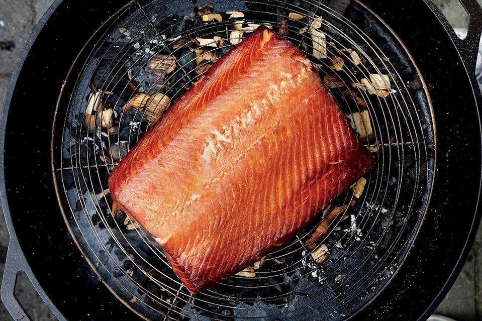 "This smoked salmon recipe is made in a skillet with wood chips, but you could also do it on an outdoor smoker if you're lucky enough to have one. <a href=""https://www.epicurious.com/recipes/food/views/hot-smoked-salmon-with-tarragon-creme-fraiche-56389865?mbid=synd_yahoo_rss"" rel=""nofollow noopener"" target=""_blank"" data-ylk=""slk:See recipe."" class=""link rapid-noclick-resp"">See recipe.</a>"