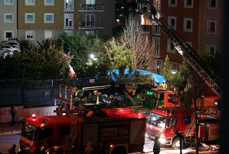 Fire fighters and police inspect the site of a helicopter crash in Istanbul