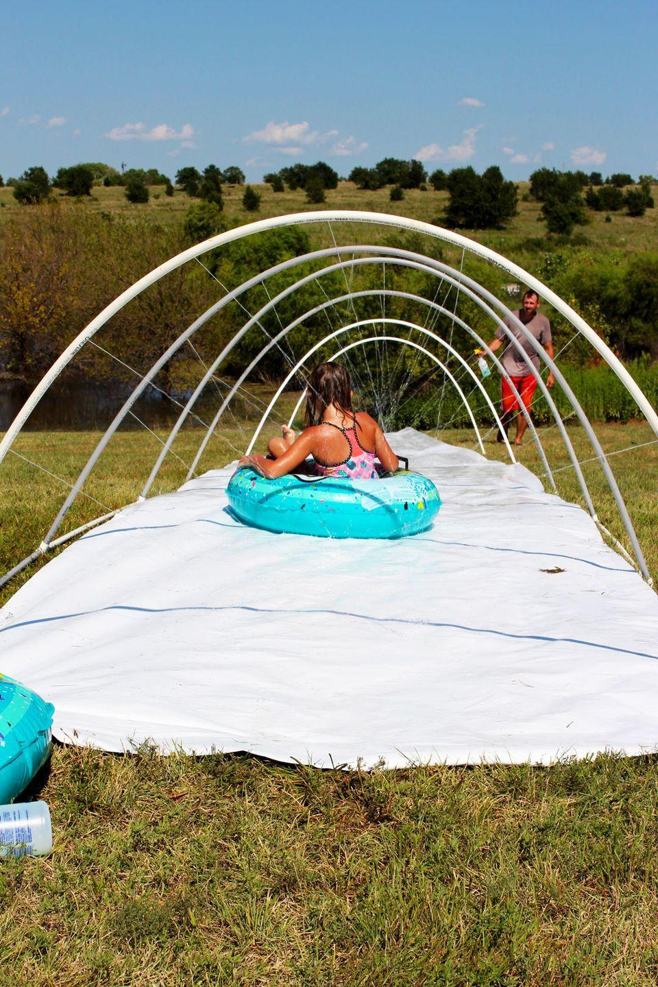 """<p>Keep this idea on hand for a hot summer day. Break out the hose and send the kids down with a splash! </p><p><strong>See more at <a href=""""https://welcometonanas.com/amazing-diy-slip-n-slide/"""" rel=""""nofollow noopener"""" target=""""_blank"""" data-ylk=""""slk:Welcome to Nana's"""" class=""""link rapid-noclick-resp"""">Welcome to Nana's</a>. </strong></p><p><a class=""""link rapid-noclick-resp"""" href=""""https://go.redirectingat.com?id=74968X1596630&url=https%3A%2F%2Fwww.walmart.com%2Fsearch%2F%3Fquery%3Dinner%2Btubes&sref=https%3A%2F%2Fwww.thepioneerwoman.com%2Fhome-lifestyle%2Fcrafts-diy%2Fg36687460%2Fbest-outdoor-games%2F"""" rel=""""nofollow noopener"""" target=""""_blank"""" data-ylk=""""slk:SHOP INNER TUBES"""">SHOP INNER TUBES</a></p>"""