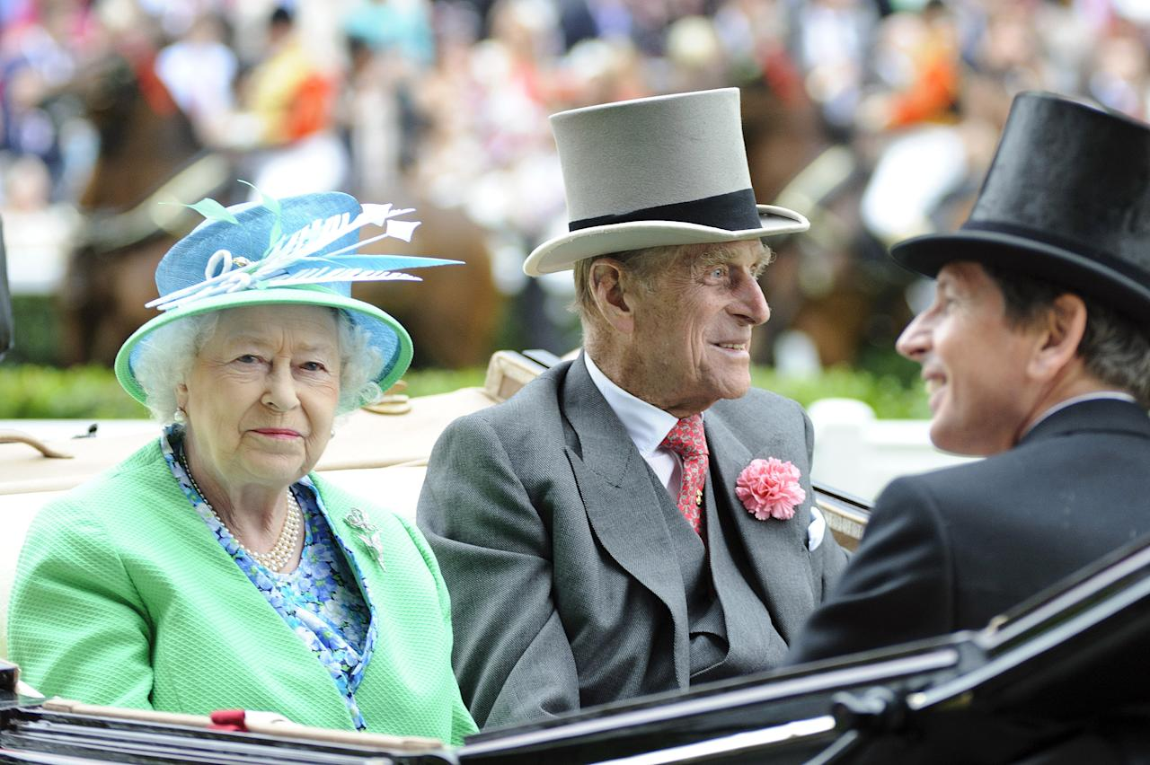 ASCOT, ENGLAND - JUNE 23:  (L-R) Queen Elizabeth II and Prince Philip attends day five of Royal Ascot at Ascot Racecourse on June 23, 2012 in Ascot, England.  (Photo by Ben Pruchnie/Getty Images)