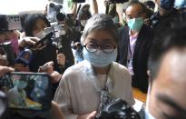 Pro-democracy activist and barrister Margaret Ng arrives at a court in Hong Kong Friday, April 16, 2021. Seven of Hong Kong's leading pro-democracy advocates, including 82-year-old veteran activist Martin Lee and pro-democracy media tycoon Jimmy Lai, are expected to be sentenced Friday for organizing a march during the 2019 anti-government protests that triggered an overwhelming crackdown from Beijing.(AP Photo/Kin Cheung)