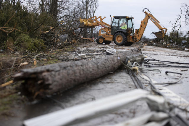 Crews work to clear roadways of debris caused by one of several tornadoes that tore through the state overnight on March 3, 2020 in Cookeville, Tennessee. At least 19 people were killed and scores more injured across the state in storms that caused severe damage in downtown Nashville. (Brett Carlsen/Getty Images)