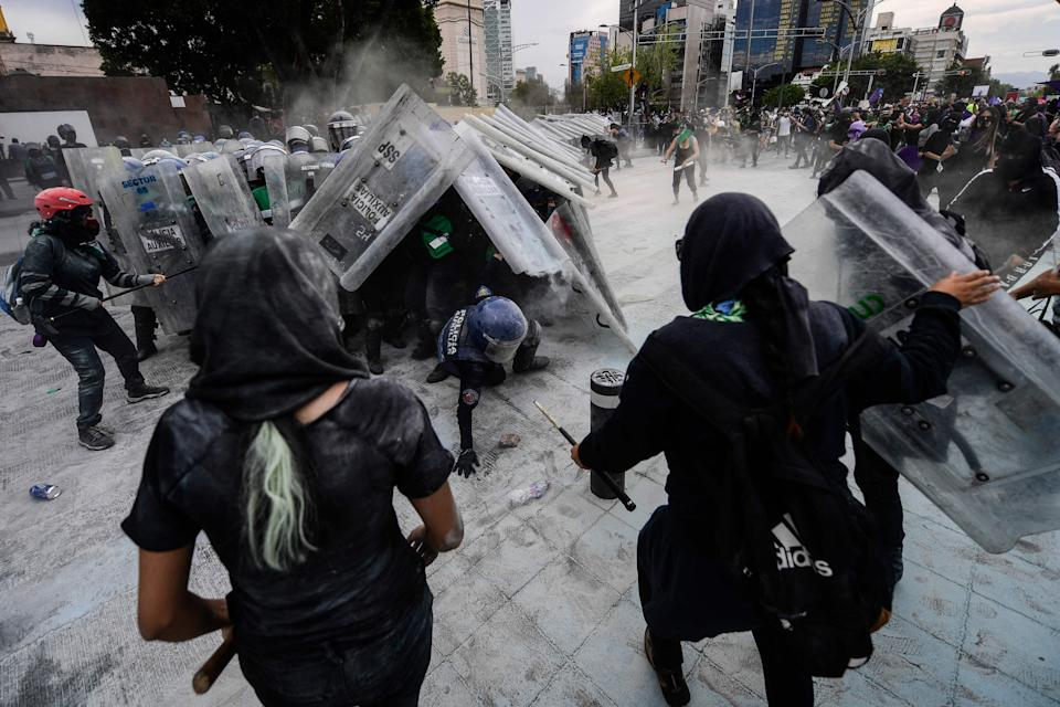 <p>Protesters clash with the police during a demonstration to commemorate the International Women's Day in Mexico City</p> (AFP via Getty Images)