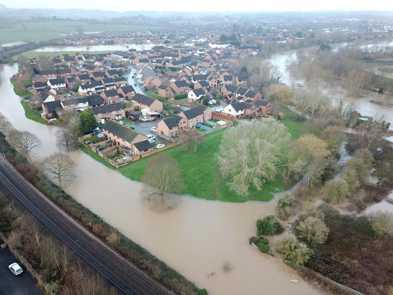 Flooding in Lower Bullingham, Hereford, in the aftermath of Storm Dennis. The Met Office's new supercomputer is intended to help beef up the UK's flood defences: PA