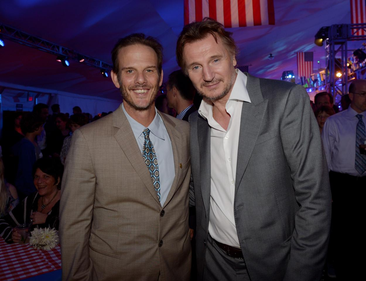 "LOS ANGELES, CA - MAY 10:  Producer/director Peter Berg (L) and actor Liam Neeson pose at the after party for the premiere of Universal Pictures' ""Battleship"" at L.A. Live on May 10, 2012 in Los Angeles, California.  (Photo by Kevin Winter/Getty Images)"